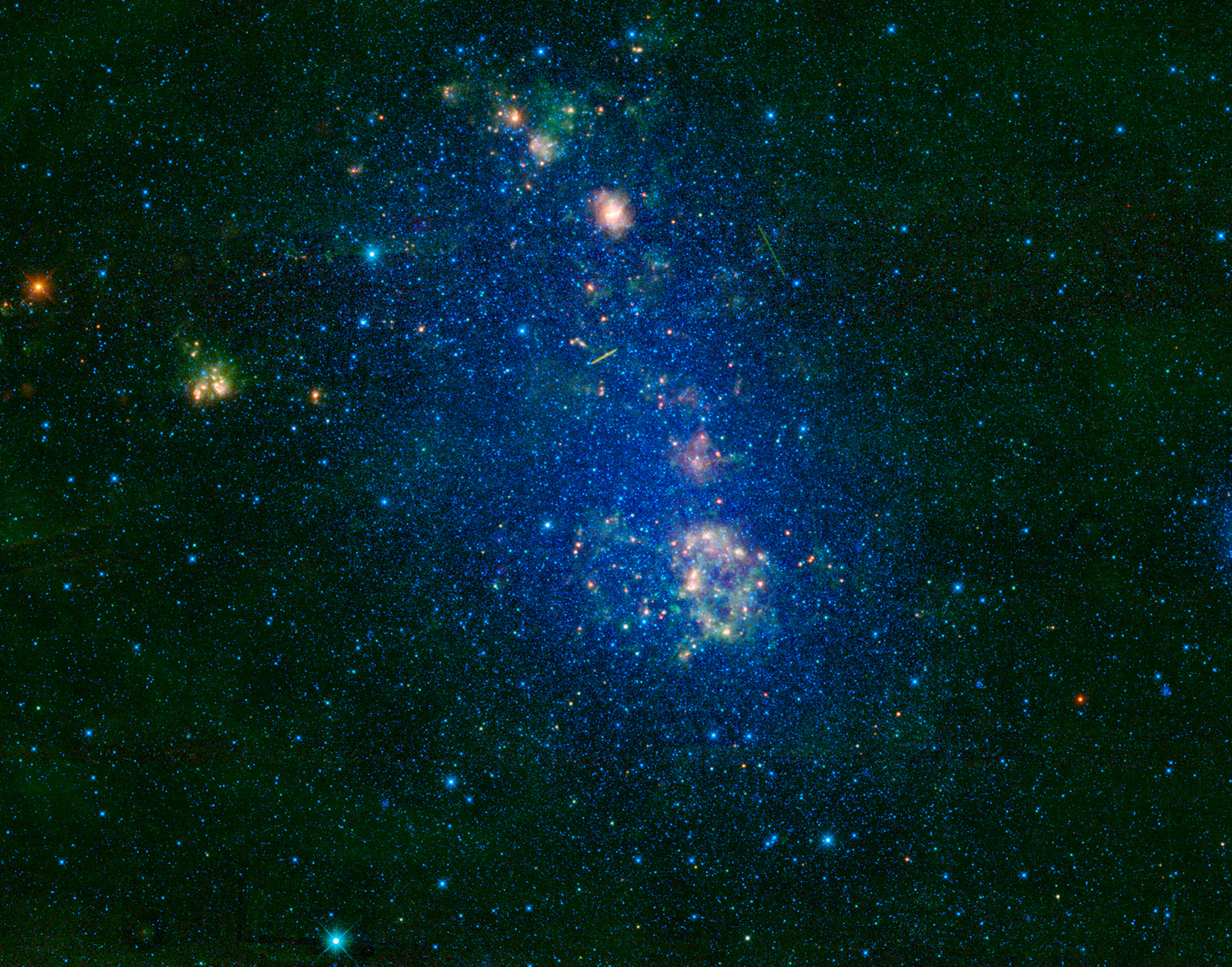 This image captured by NASA's Wide-field Infrared Survey Explorer (WISE) highlights the Small Magellanic Cloud.  Also known as NGC 292, the Small Magellanic Cloud is a small galaxy about 200,000 light-years away.